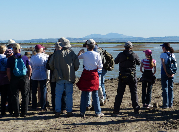 Hikers gather for an overview of the spectacular project.